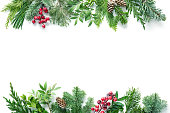 istock Flat lay composition with winter fir branches, cones, holly isolated on white background 1196144184