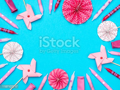 945748362istockphoto Flat lay decoration party concept on colored background 1157122717