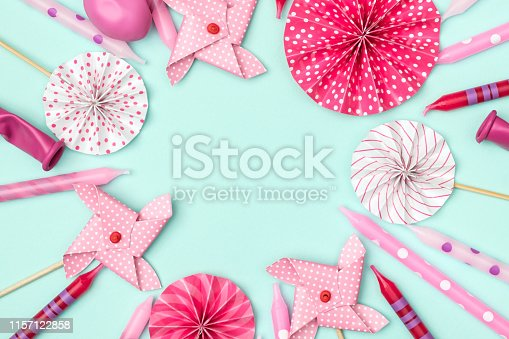 945748362istockphoto Flat lay decoration party concept on colored background 1157122858
