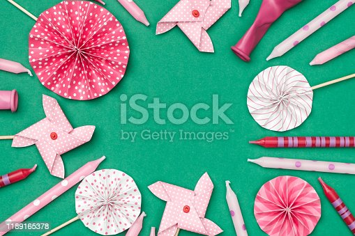 945748362istockphoto Flat lay decoration party concept on colored background with copy space top view 1189165378