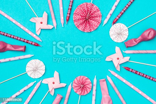 945748362istockphoto Flat lay decoration party concept on colorful background top view 1156999439