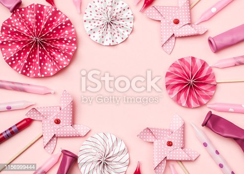 945748362istockphoto Flat lay decoration party concept on colorful background top view 1156999444