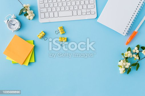 istock Flat lay desk and branch with green leaves 1035688890