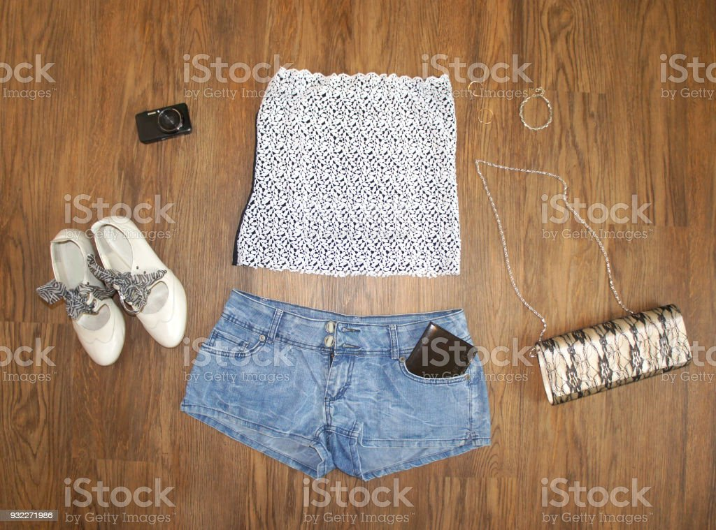 3f5a57dc8b07 flat lay feminine clothes and accessories collage: lace top, denim shorts  with a passport