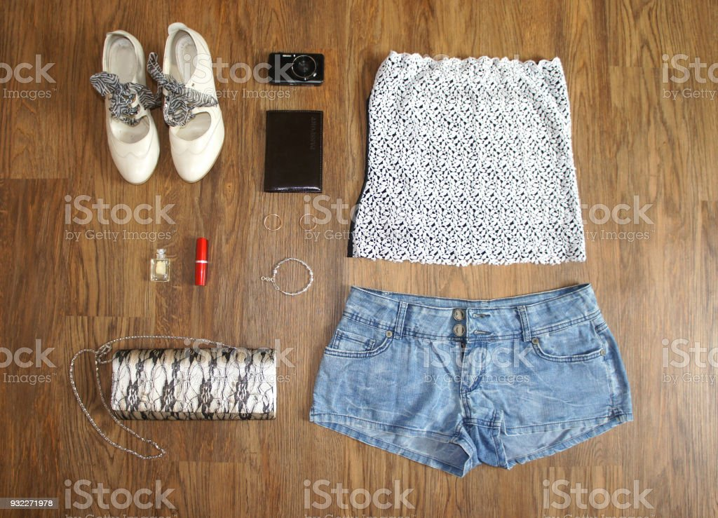 a91642a7084a flat lay feminine clothes and accessories collage: lace top, denim shorts,  clutch bag