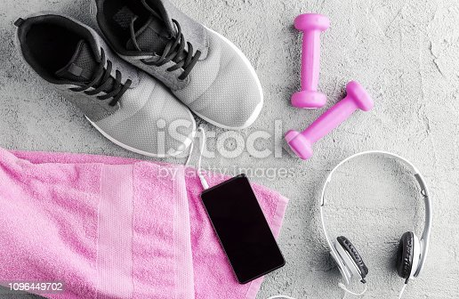 istock Flat lay fitness composition. Sneakers, smartphone and headphones 1096449702