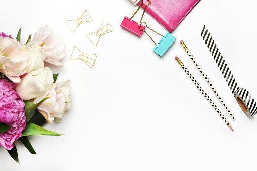 Flat lay. Flower on the table. Stationery items. Table view. Mock-up background. Peonies