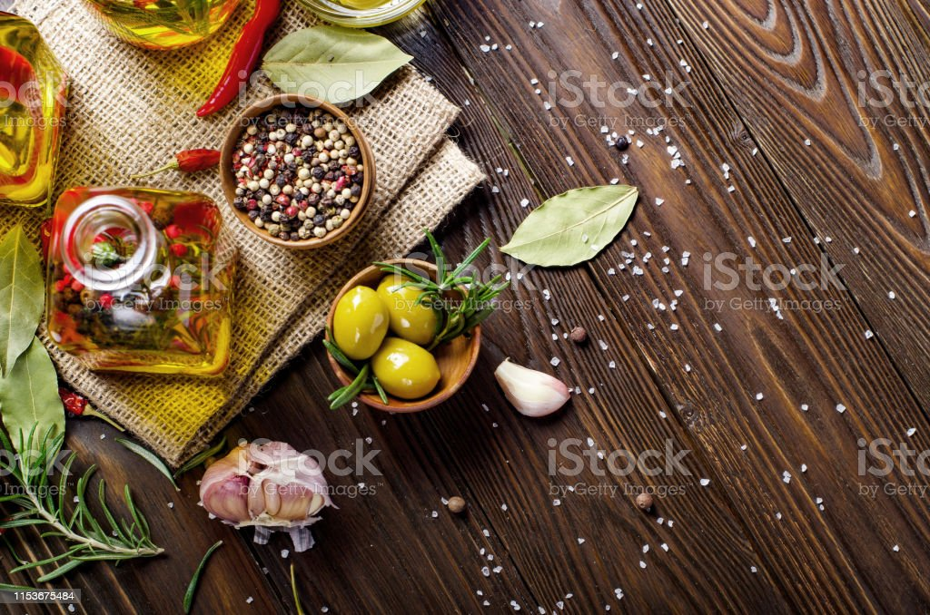 Flat lay food background made of oils condiments and spices on...