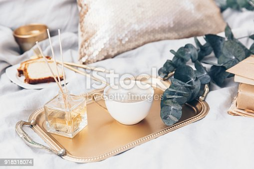 istock Flat lay hipster composition. Blogger background with craft notepad, coffee in bed and breakfast 918318074