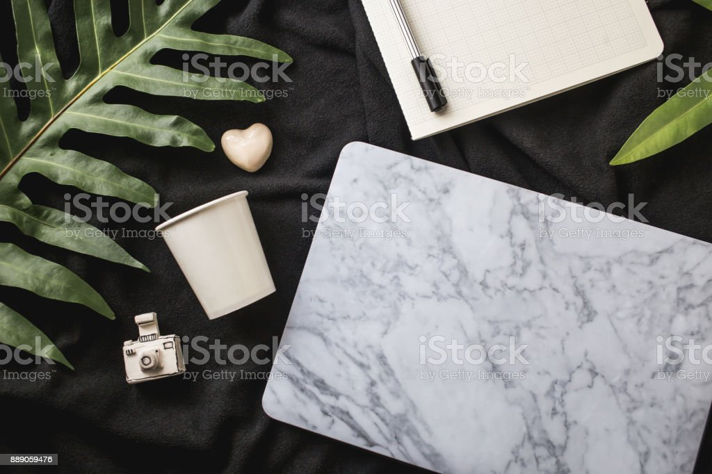 Flat lay home office bed workspace stock photo