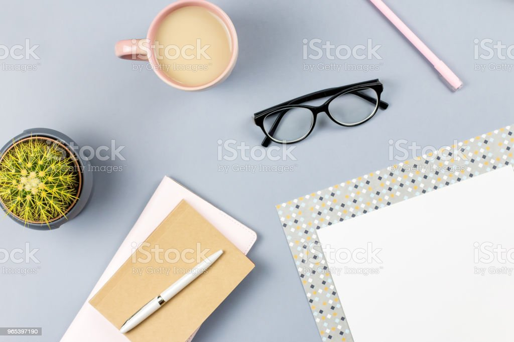 Flat lay home office desk. Female workspace with planner, eyeglasses, tea mug, diary, plant. Copy space royalty-free stock photo