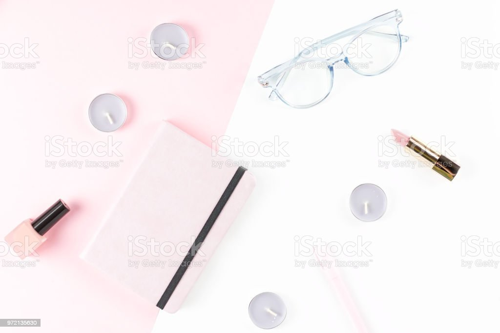 Flat lay home office desk. Female workspace with planner, eyeglasses,...