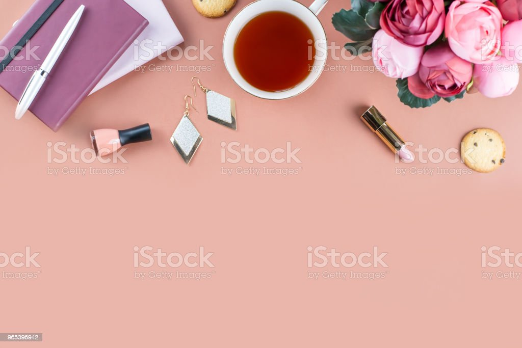 Flat lay home office desk. Feminine workspace with diary, flowers, sweets, fashion accessories. Fashion blogger concept. royalty-free stock photo