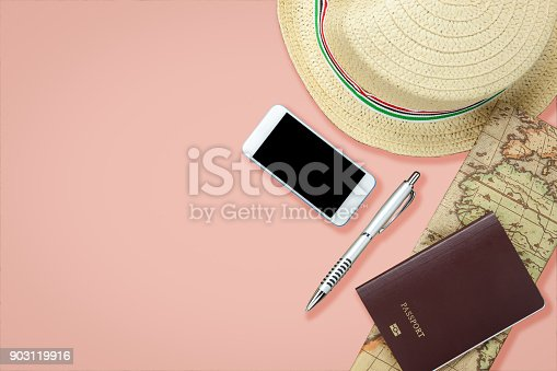 istock Flat lay image of accessory clothing man or women to plan travel in holiday background concept.Mobile phone & passport with many item in vacation season.Table top view several object on pink paper. 903119916