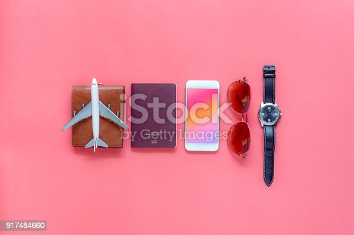 istock Flat lay image of accessory clothing man or women to plan travel in holiday background concept.Mobile phone & passport with many item in vacation season.Table top view several object on pink paper. 917484660