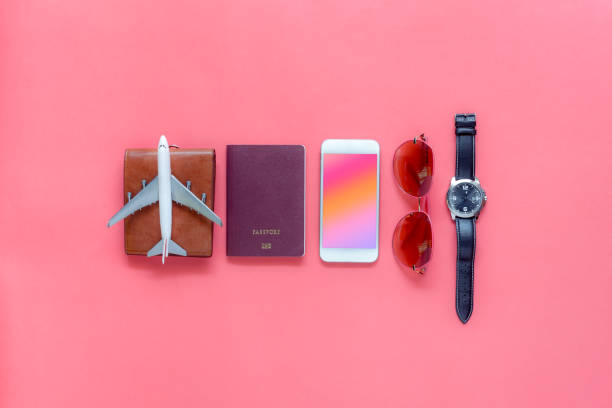 flat lay image of accessory clothing man or women to plan travel in holiday background concept.mobile phone & passport with many item in vacation season.table top view several object on pink paper. - travel imagens e fotografias de stock