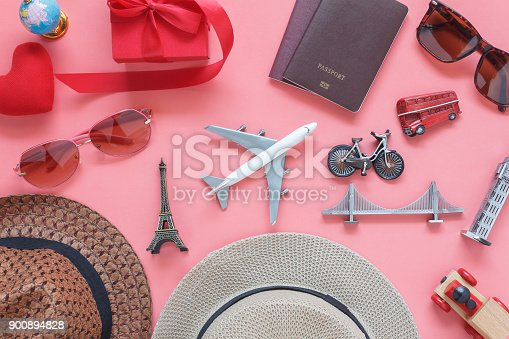 istock Flat lay image of accessory clothing women to plan travel in valentine's day background concept.Passport & clothes with many essential  items in holiday season.Several objects on  modern pink paper. 900894828