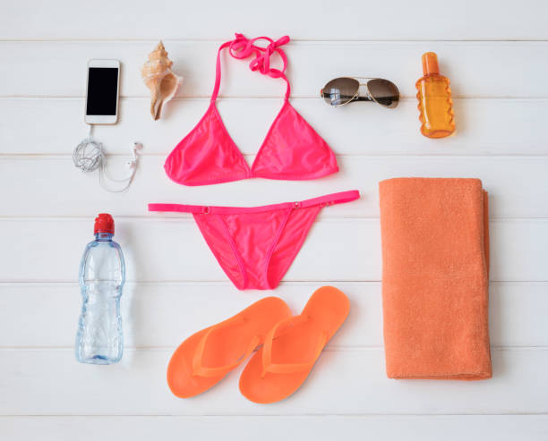Flat lay items for sunbathing stock photo