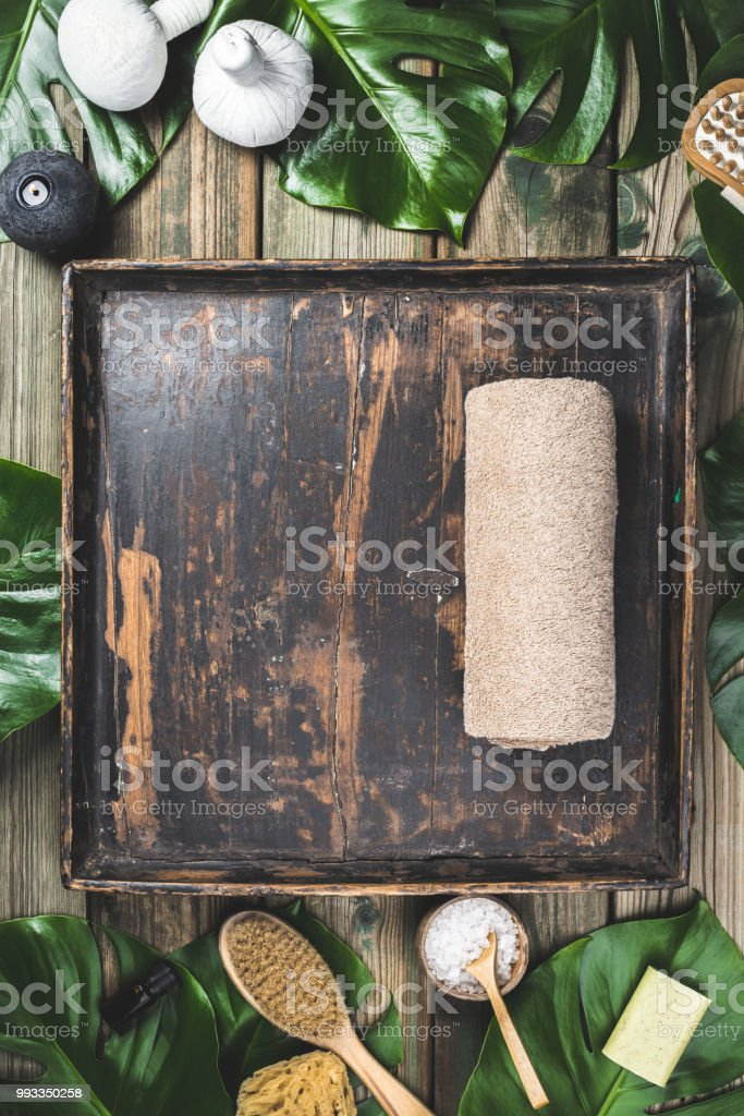 flat lay layout with monstera leaves and cosmetic care products stock photo