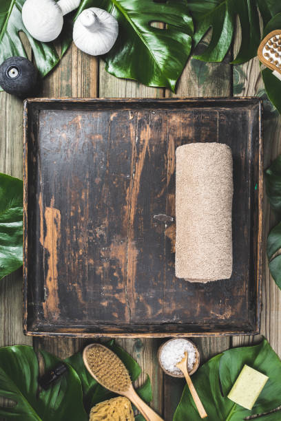flat lay layout with monstera leaves and cosmetic care products - spa belgium stock photos and pictures