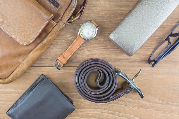 flat lay leather for men. - armband vintage stock-fotos und bilder