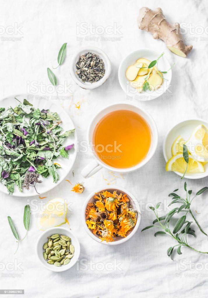 Flat lay liver detox antioxidant tea and the ingredients for it on a light background, top view. Herbal homeopathic recept stock photo