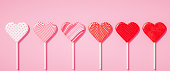 Flat lay lollipops on stick in row with different pattern textures, love concept, Valentines day pastel pink background 3d illustration