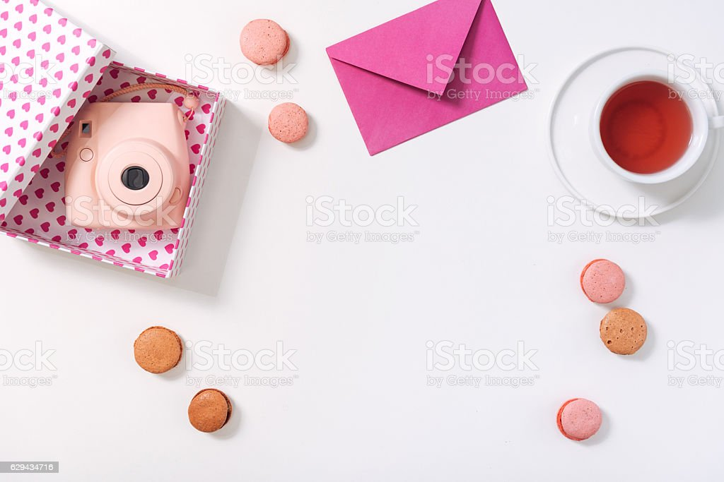 Flat lay of a box with photo camera in it stock photo