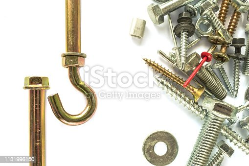 Flat lay of anchor isolated on white. Self Drilling screws. Isolated fasteners. Connecting material on white background