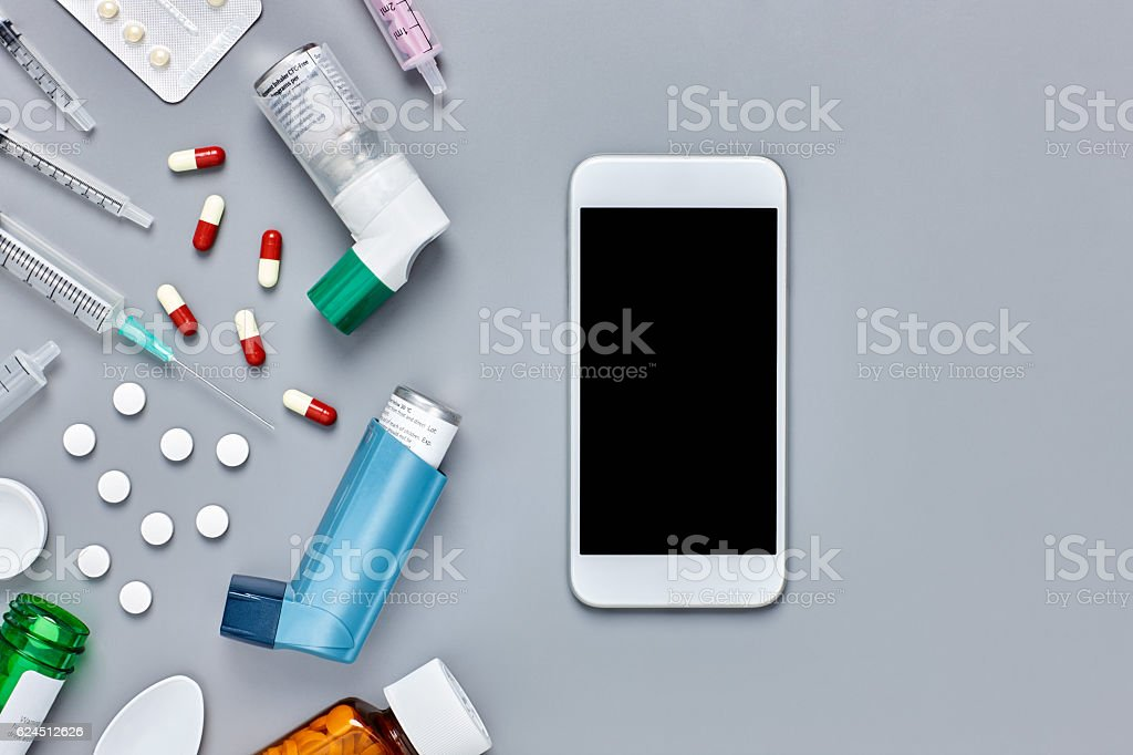 Flat lay of asthma inhalers and medicines with smart phone stock photo