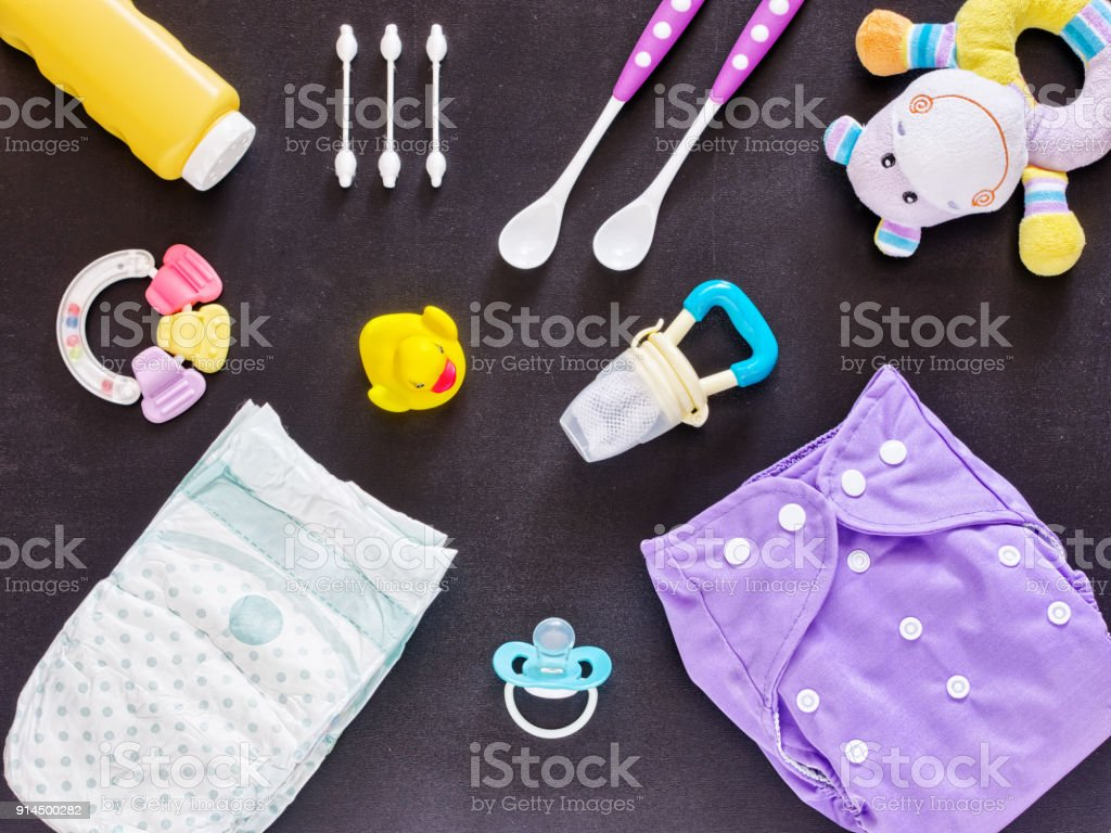 Flat lay of baby set with cloth diaper stock photo