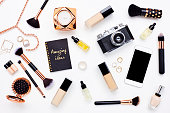 istock Flat lay of beauty products on bloggers desk 614836502