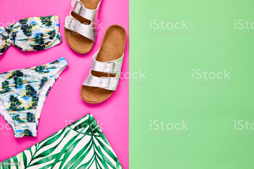 Flat lay of bikini sandal and towel with copy space. Color Blocking. stock photo