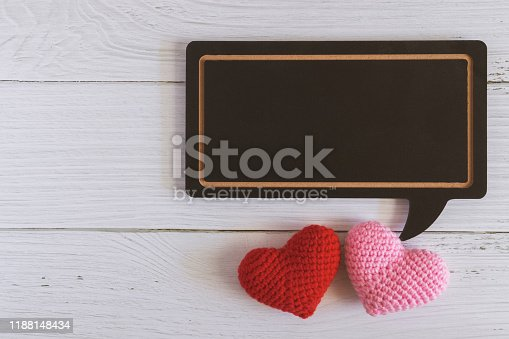 istock Flat lay of black blank speech bubble wooden sign on white marble background with red and pink hearts. Concept of couple, family, friend, lover and Valentine. Love photo frame 1188148434