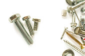 Flat lay of bolts isolated on white. Self Drilling screws. Isolated fasteners. Connecting material on white background