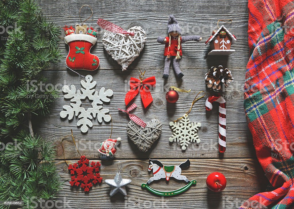 Flat lay of Christmas decoration and ornaments on wooden backgro stock photo