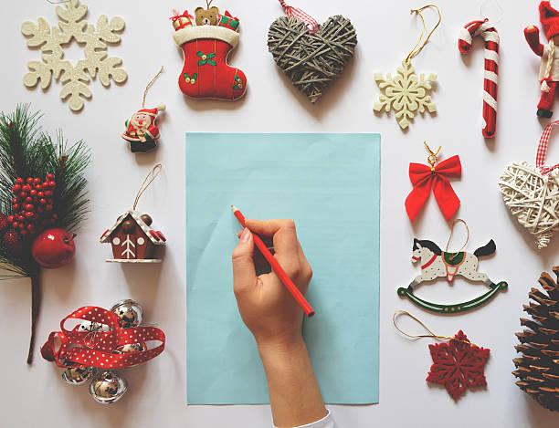 flat lay of christmas decoration ornaments on white background - weihnachts wunschliste stock-fotos und bilder