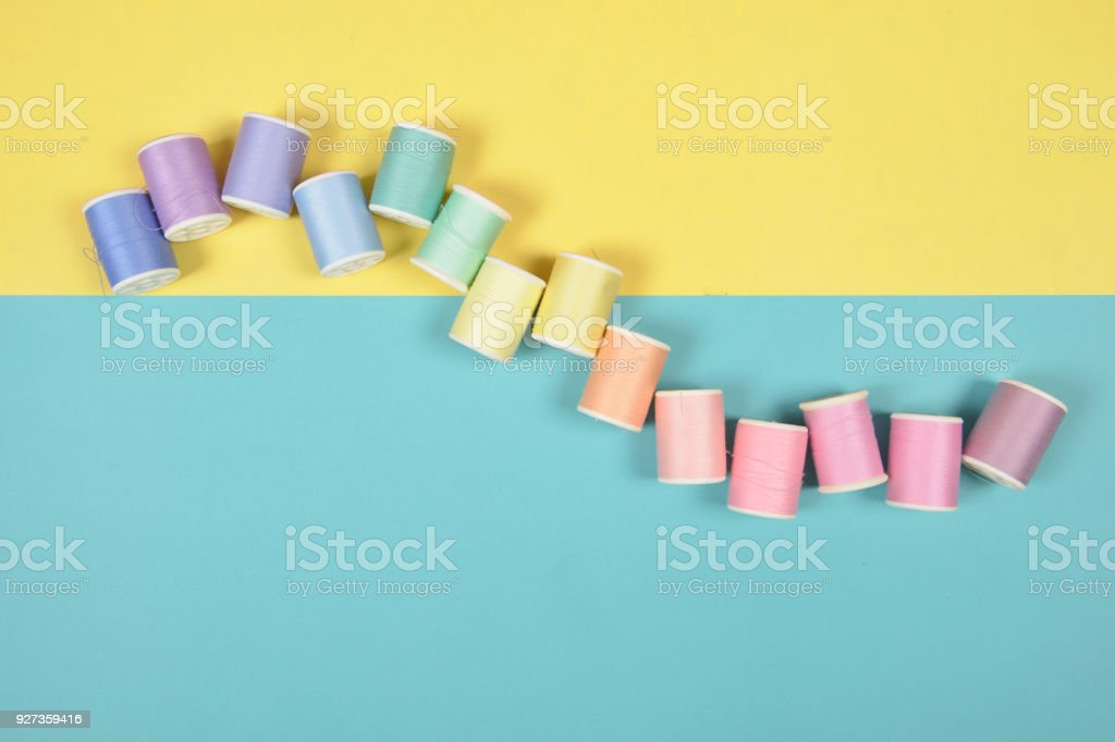 Flat lay of colored thread rolls for sewing on two tone background, Sewing and needlework concept. - Royalty-free Clothing Stock Photo