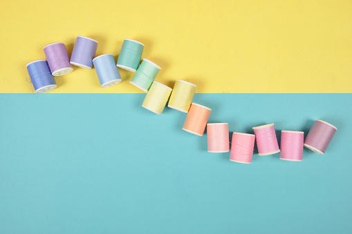 Flat Lay Of Colored Thread Rolls For Sewing On Two Tone Background Sewing And Needlework Concept Stock Photo - Download Image Now