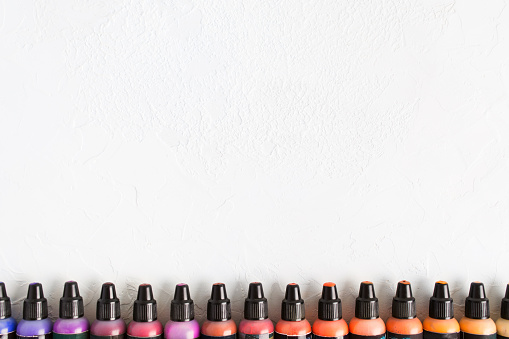 istock Flat lay of colorful paints in battles with copy space 1038606114