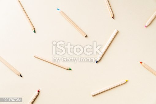 Kids coloring pencils on yellow background. Back to school colorful flat lay