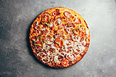 istock Flat lay of delicious pizza on gray background 1171560651