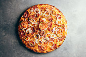 istock Flat lay of delicious pizza on gray background 1171560697