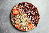 istock Flat lay of delicious pizza on gray background 1171560706