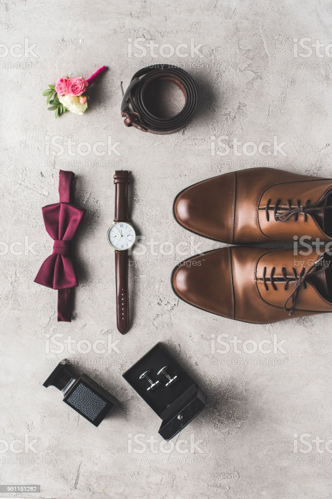 flat lay of elegant wedding accessories on gray surface stock photo