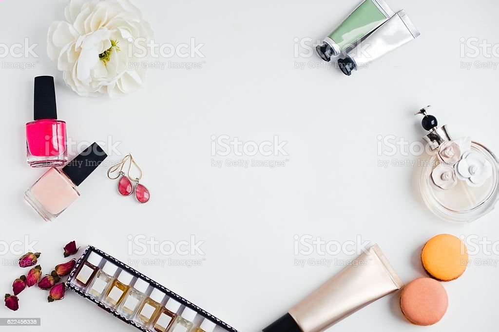 Flat lay of fashion beauty products on a white background stock photo