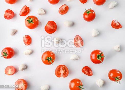 1136817041 istock photo Flat lay of fresh cherry tomatoes and mozzarella cheese 1214453656
