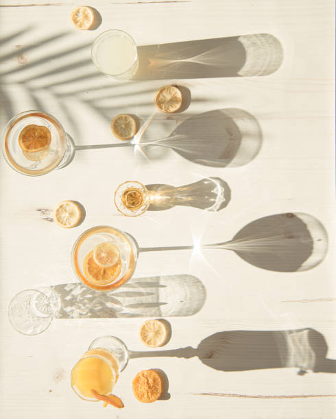 platt lay av glas och koppar i hårt ljus - abstract silhouette art bildbanksfoton och bilder