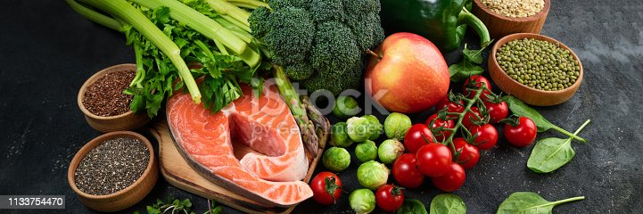 istock Flat lay of healthy food. Selection of healthy eating fish, vegetables, beans, antioxidants and sources of omega 3. Healthy food for heart, diet and healthy lifestyle concept 1133754470