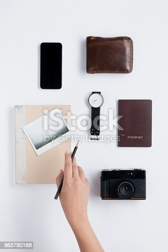 istock Flat lay of Human hand hold pencil and accessories 865780168